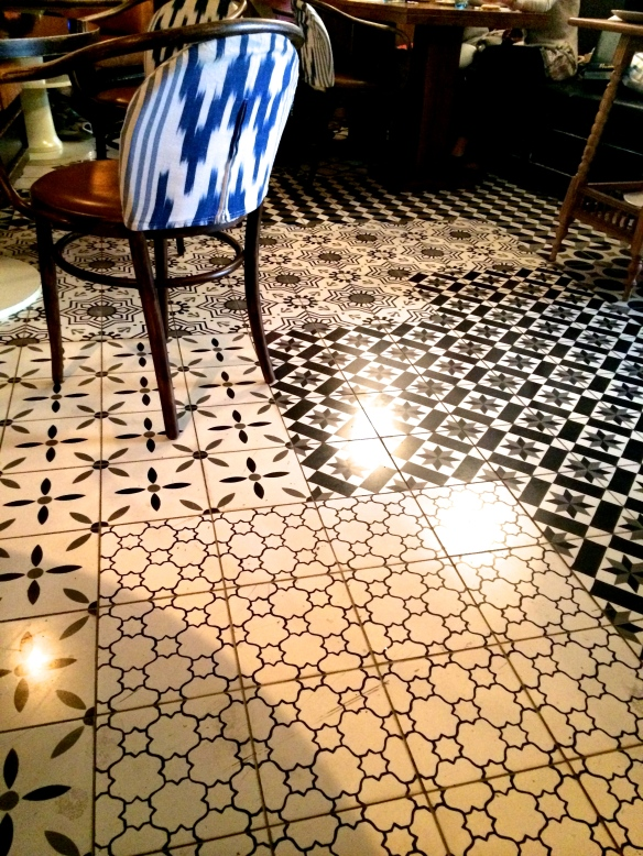 I love the contrast between the blue and white matte patterns on the chair with the shiny monocrome floor patterns.